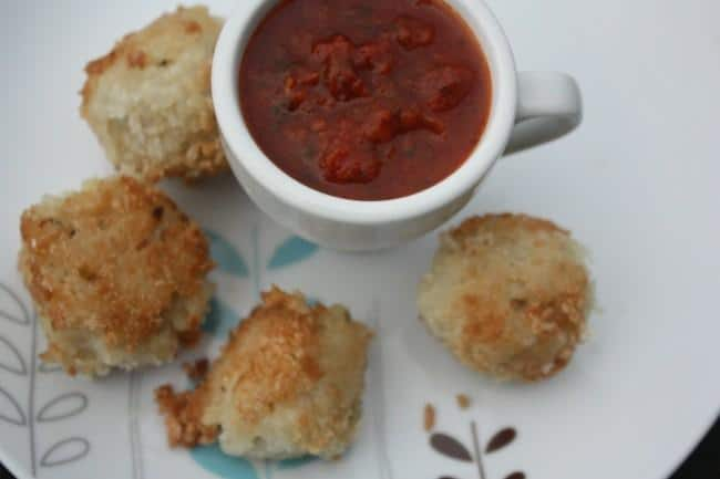 Arancini (fried risotto balls) with tomato sauce