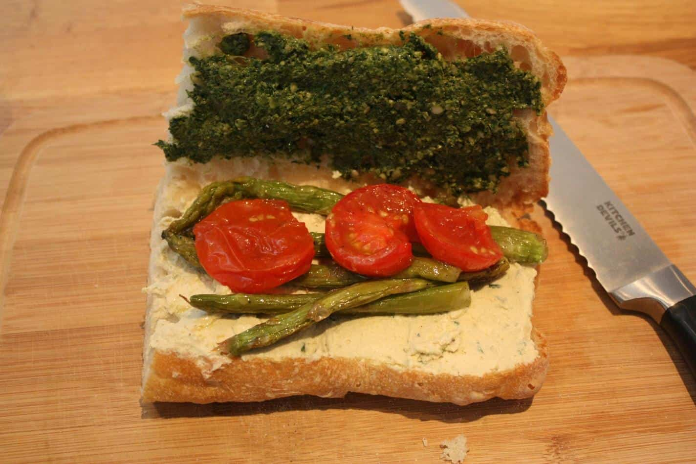 Vegan pesto, cashew cheese, roasted asparagus and tomato sandwich