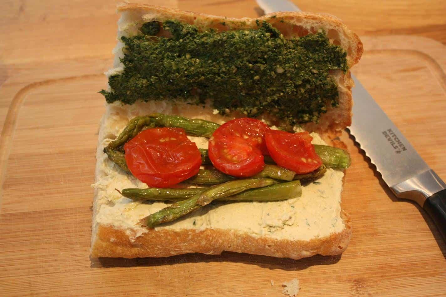 Vegan pesto, cashew cheese, roasted asparagus and tomato sandwich
