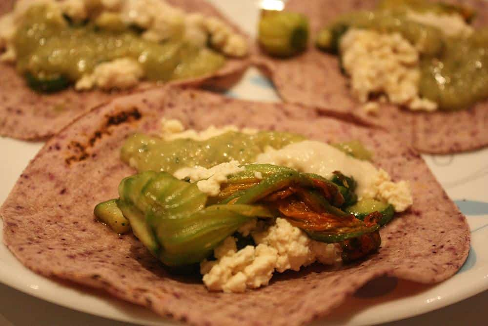 Courgette flower (zucchini blossom) tacos with tofu cotija cheeseand roasted tomatillo salsa