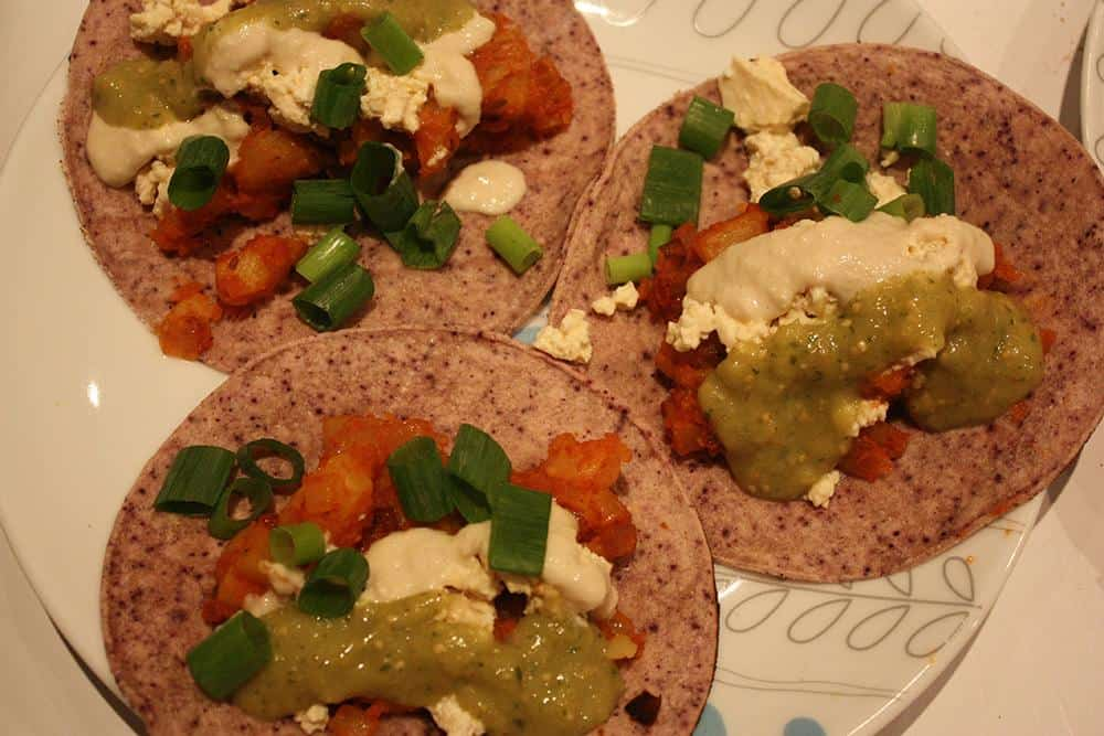 Chipotle potato tacos with roasted tomatillo salsa and vegan crema
