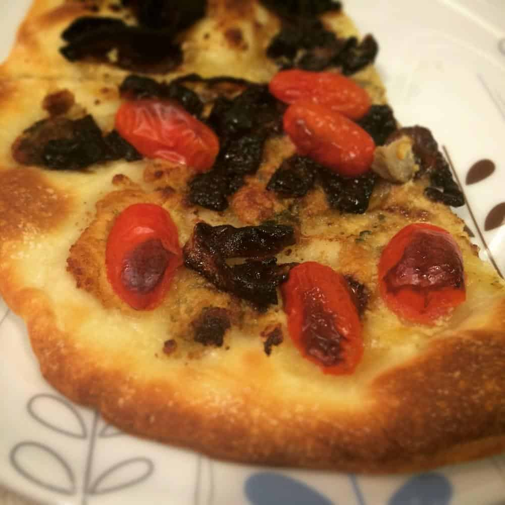 Vegan gorgonzola, caramelised onion and tomato pizza