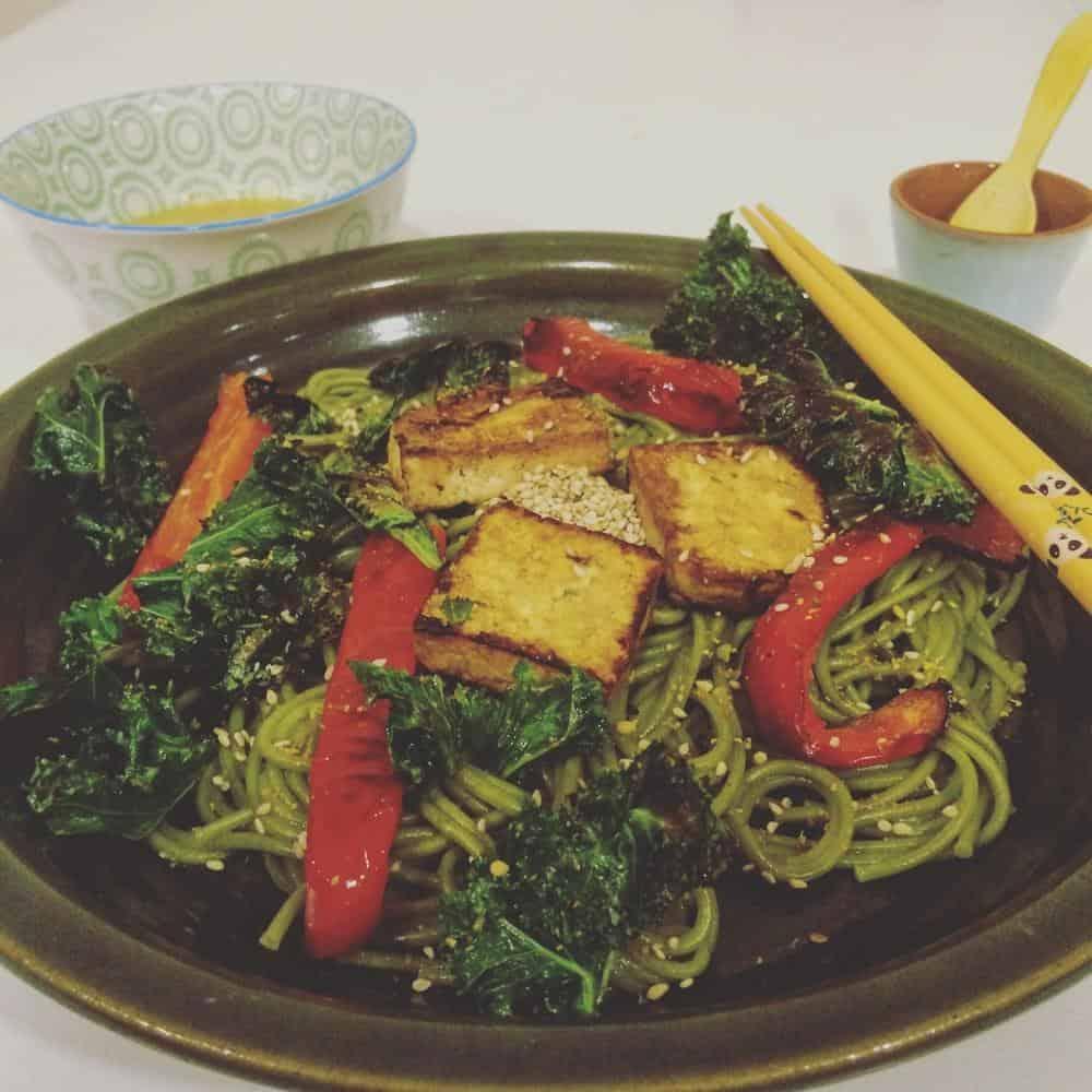 Vegan green tea soba with miso-lime sauce and crispy kale