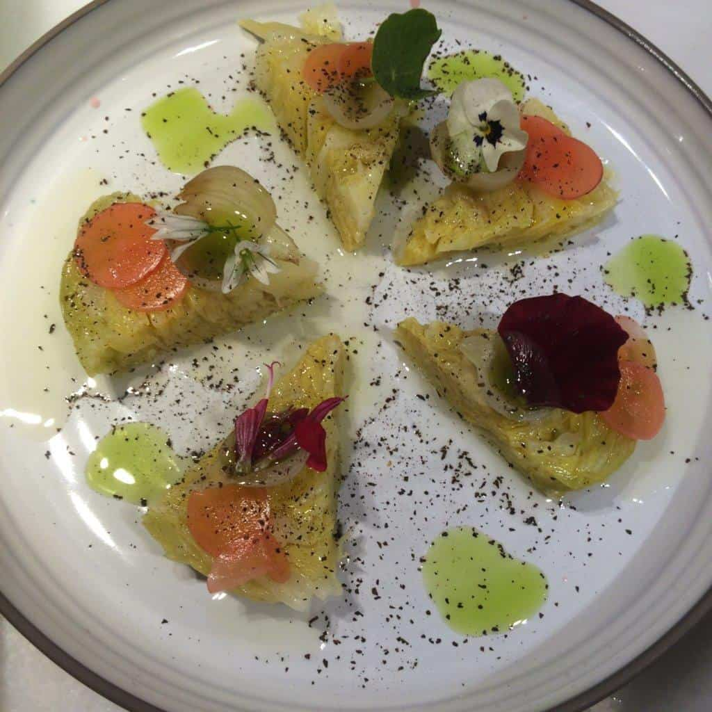 Cabbage wedges with mustard oil, pickled daikon and flower petals, Celeri, Barcelona
