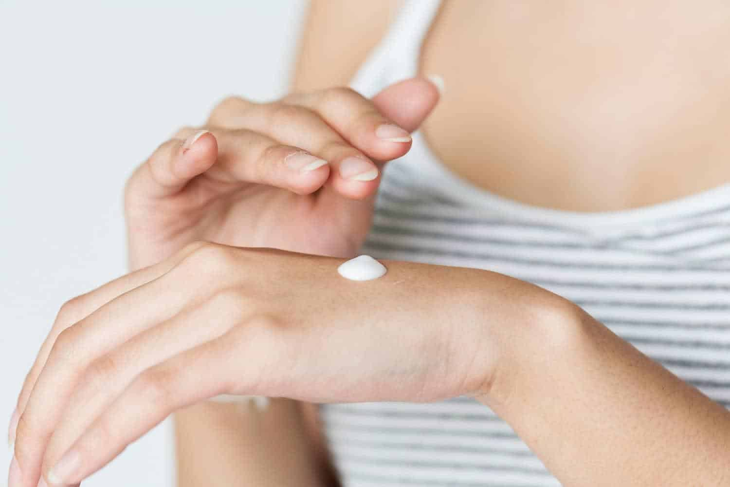 Dab of sunscreen on a woman's hand