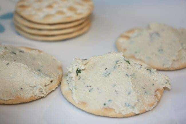 Crackers with vegan cheese spread on them