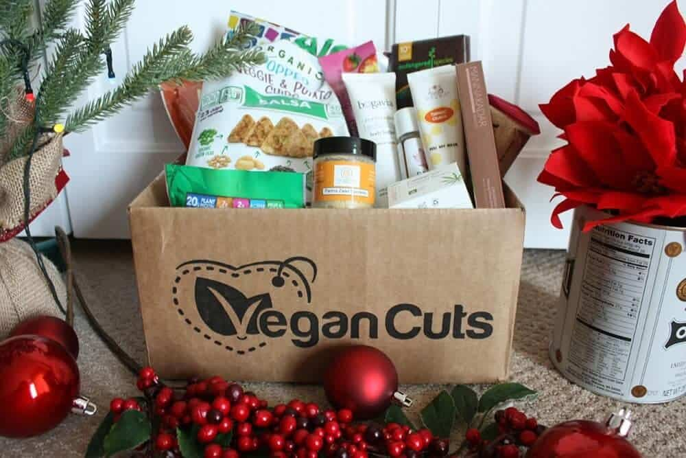 Vegancuts box full of snacks and beauty products. Vegan gifts: vegan box