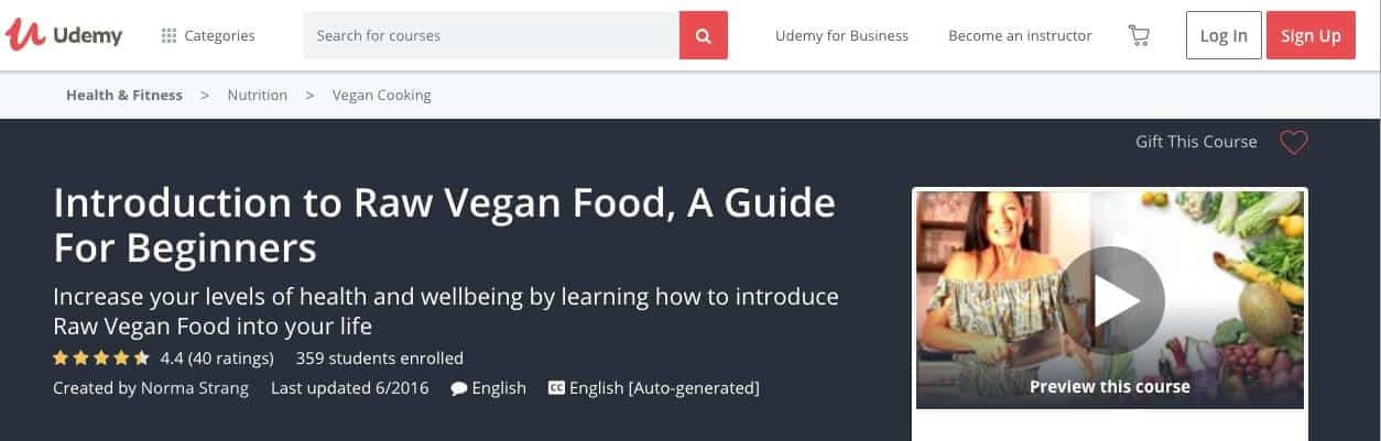 Screenshot of Udemy raw vegan class page showing instructor with row of vegetables