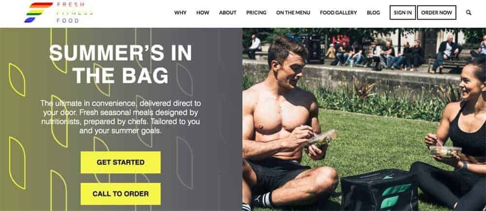 Screenshot of healthy food delivery uk - fresh fitness food's page showing two people eating in a park