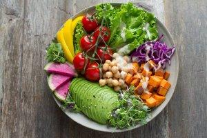 A bowl of colourful veggies sits on a wooden table. Vegan meal kits: the best vegan meal kits. See reviews, pricing and discounts and find the vegan meal kit for you