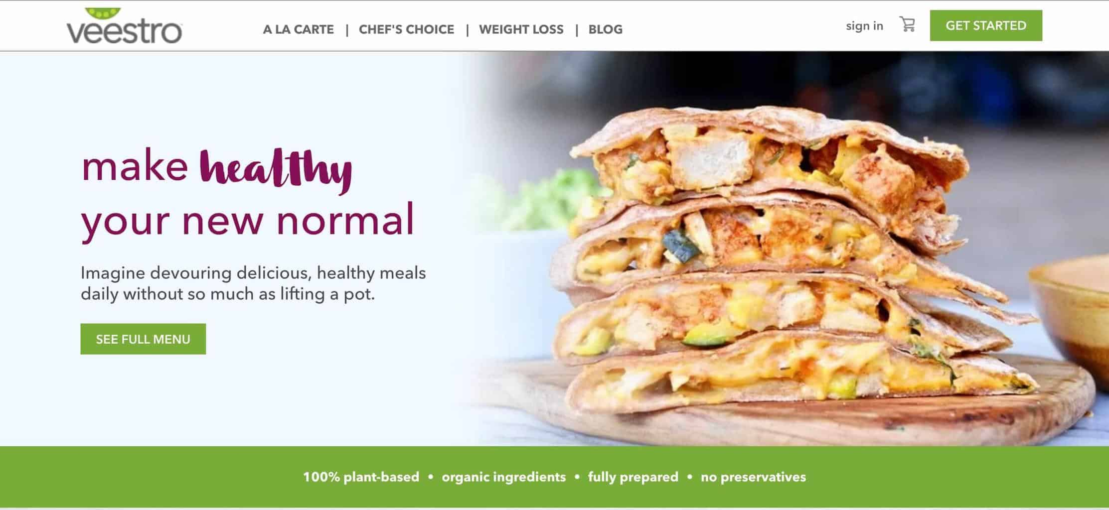 Screenshot of Veestro website showing a stack of sandwiches