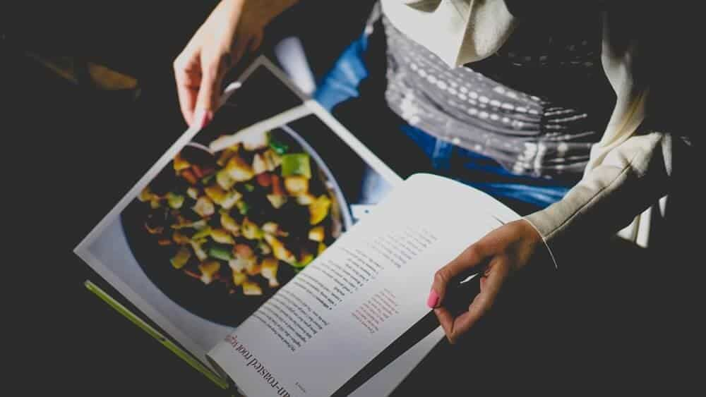 Person reading a cookbook