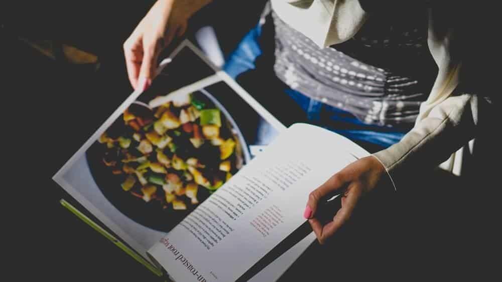 Person reading a cookbook