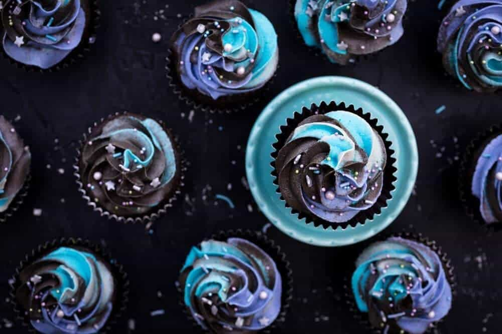 Cupcakes with blue and purple frosting.