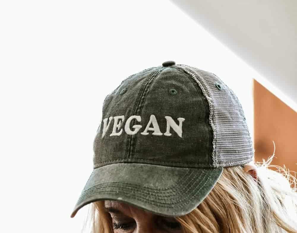 Woman wearing hat that says vegan