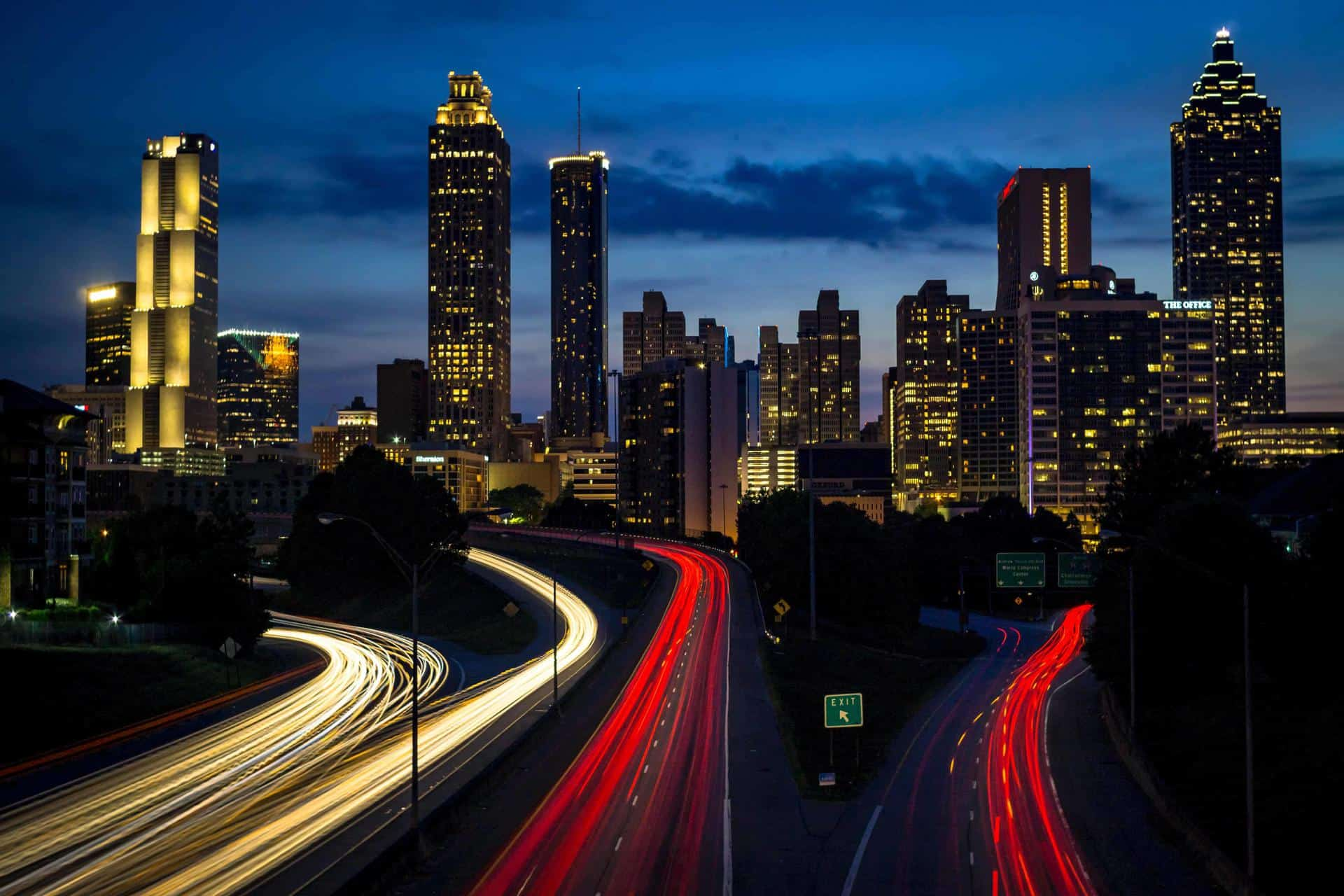 Aerial night shot of lit up buildings and roads