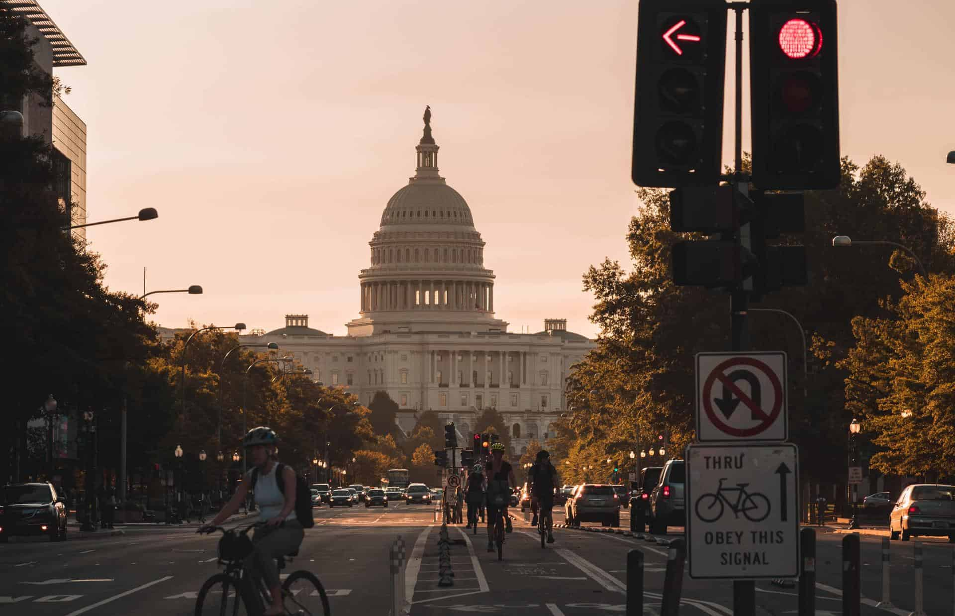 The Capitol building at dusk with streetlights in the foreground