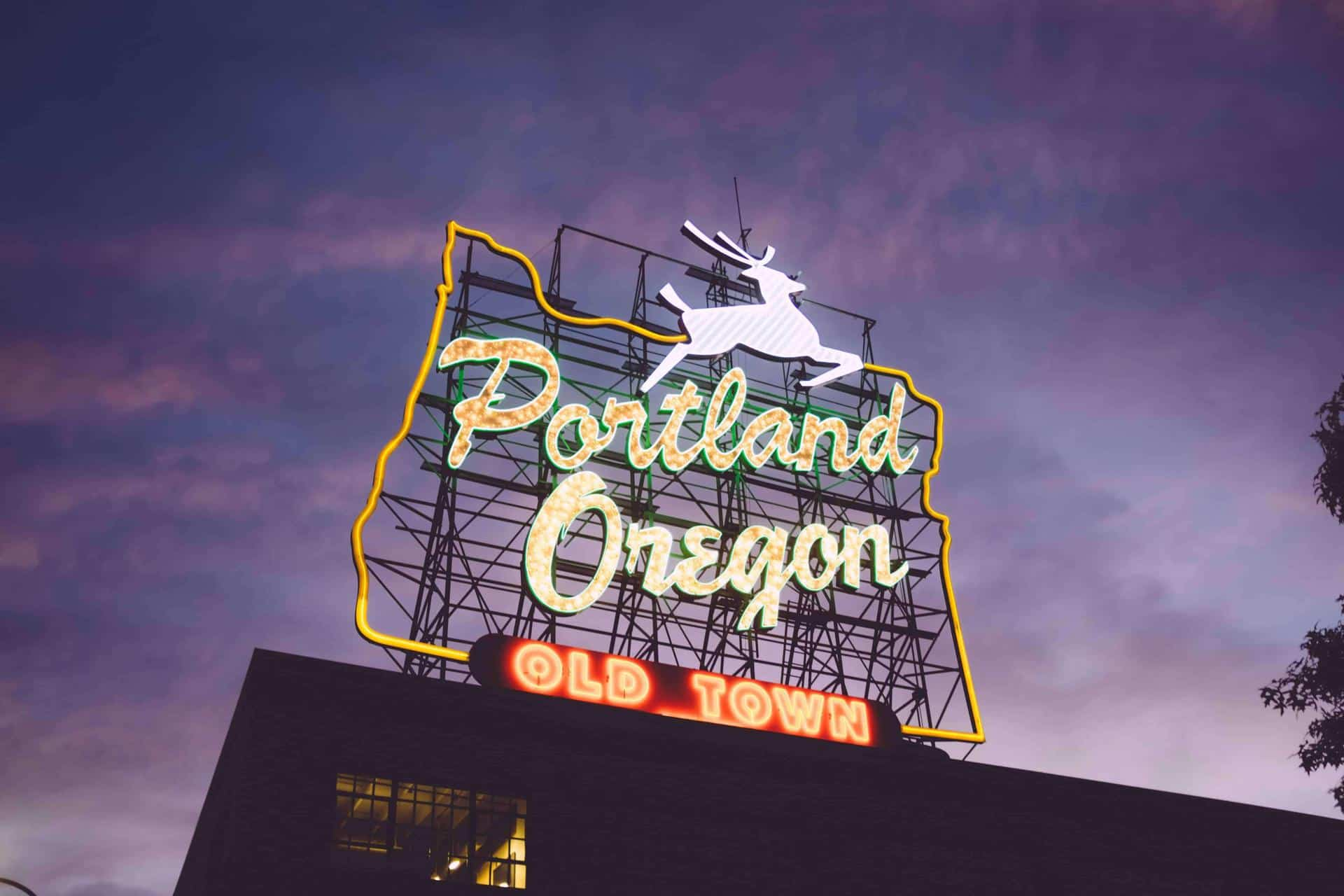 """A neon sign that says """"Portland, Oregon Old Town"""""""