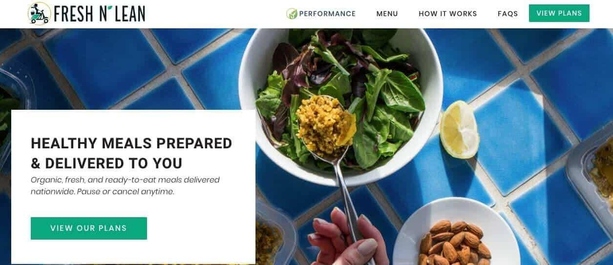 Screenshot of Fresh n Lean site showing a bowl of salad with a lemon and almonds on blue tile table