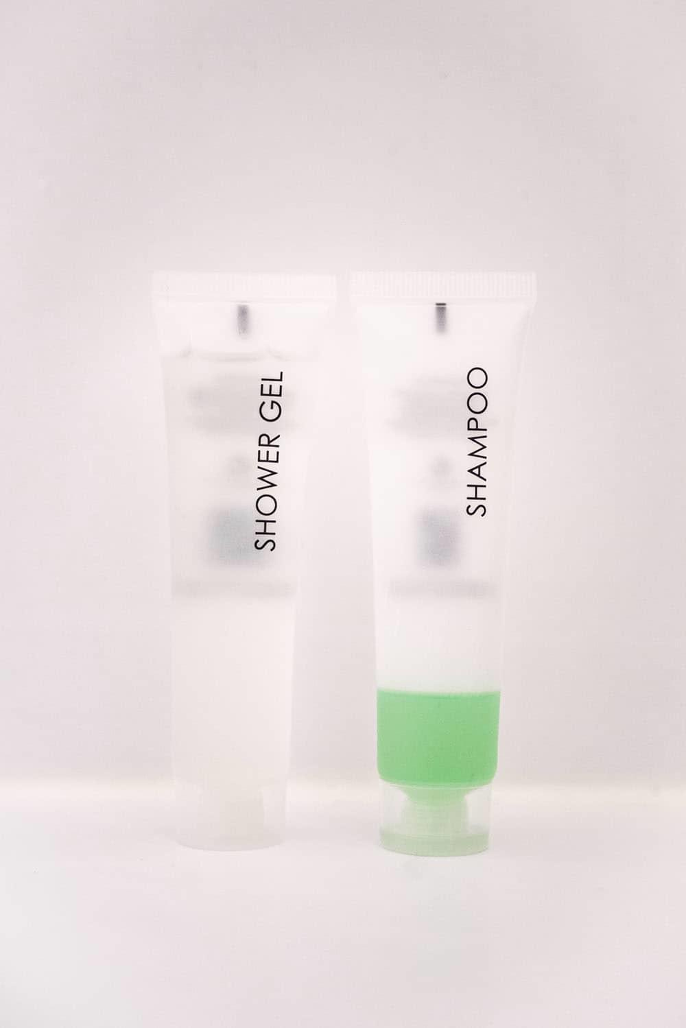 clear bottles labelled shampoo and shower gel