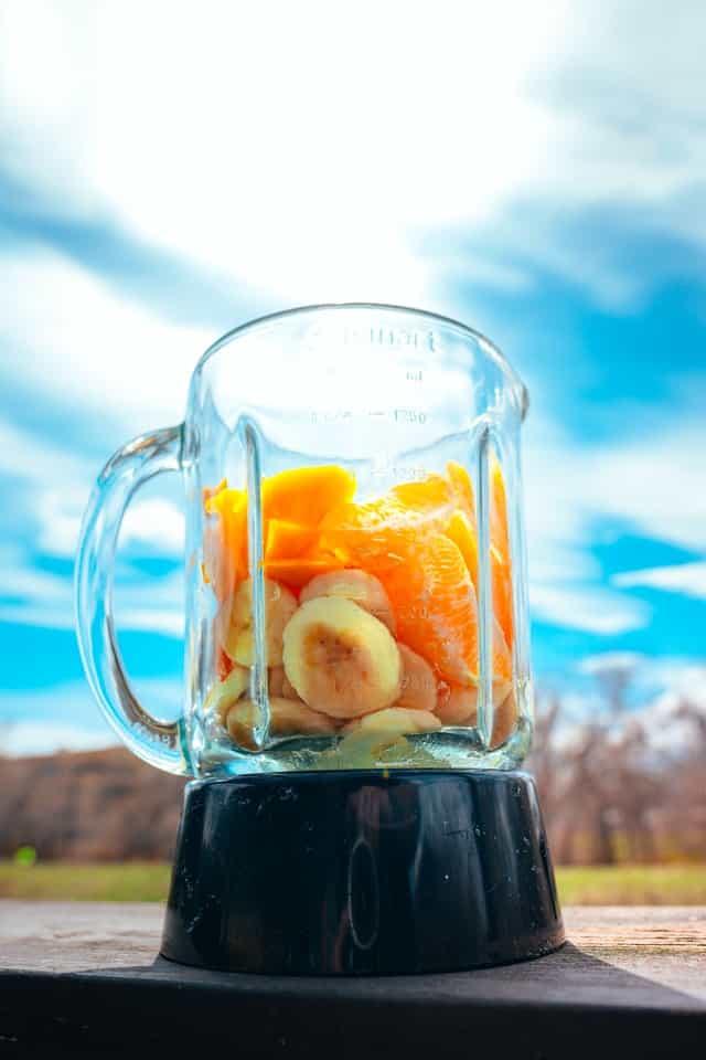 Blender containing fruit