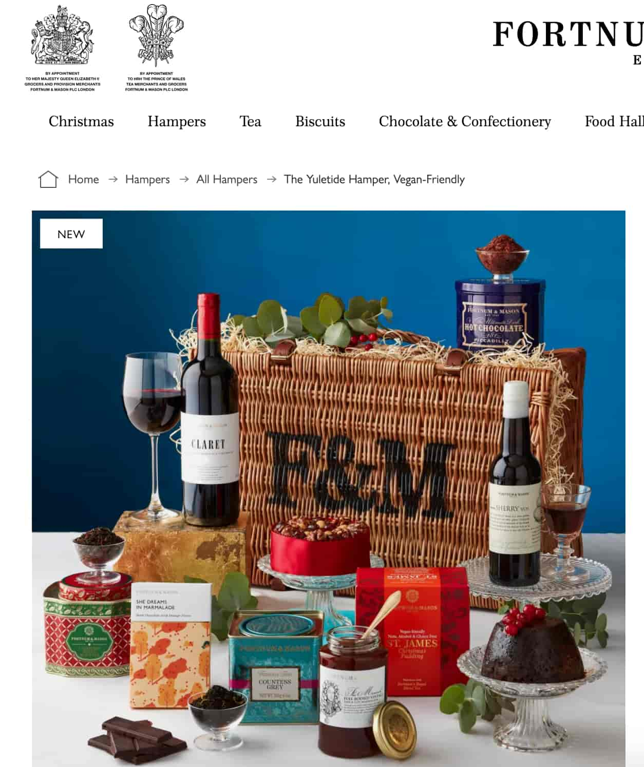 Fortnum & Mason hamper in the background with wine, jam, chocolate and tea in the foreground