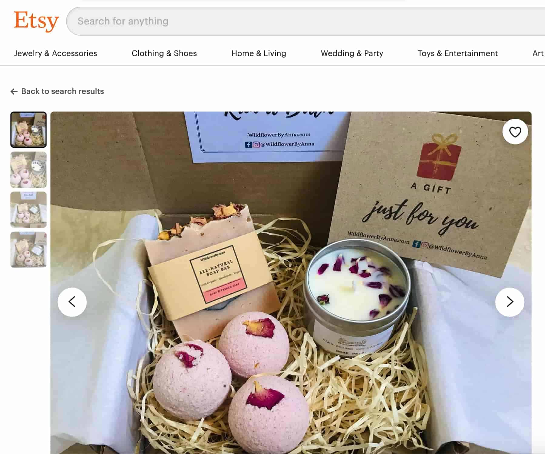 """Box containing straw, bath bombs, soap and a candle with a card that says """"a gift just for you"""""""